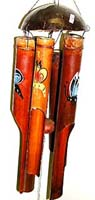 Dark brown bamboo wind chime with assorted color butterflies painted on each and half nut shell on top pipe