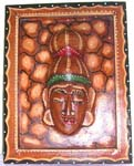 Rectangular brown wooden tribal face plaque