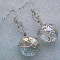 Fish hook fashion earring with wired-in star transparent white glass bead suspended on bottom