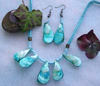 Necklace and earring jewelry set with blue color multi strings, seed beads and genuine seashells