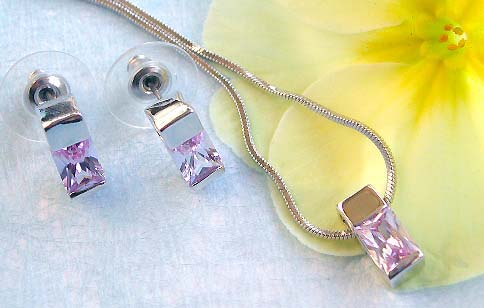 Trendy jewelry importer offering chain necklace, capped rectangular purple cz pendant and stud earring set