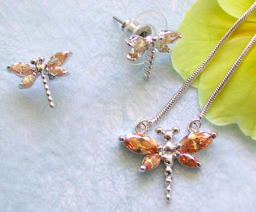 Wholesaler's dragonfly jewelry online presenting chain necklace, orange cz dragonfly pendant and stud earring set